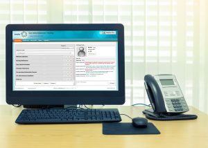 computer landline desk with screenshot