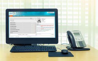 computer landline desk with screenshot